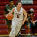 Justin Jaworski dribbles a basketball