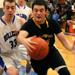 Elmwood Park's Joe Uvelli tries to save a ball from going out of bounds
