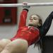 Hinsdale Central junior Maddie Sesemann competes on the uneven parallel bars