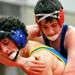 Lyons freshman Johnny Mologousis takes on Marmion's Matt Ferraro