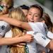 New Trier's Bina Saipi celebrates with her teammates after scoring