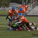 Submitted photo Broncos defenders Christian Olson, Corey Smith, Chad Anderson and Tarrell McDuffie take down a Midwest Nightmare player Saturday at Spring Lake Park High School.