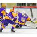 Cretin-Derham Hall's Ryne Mohrman goes after a puck behind his own net against Centennial. Mohrman scored a shorthanded goal to tie the game at 2 late in the second period. Photo by Jeff Lawler, SportsEngine