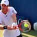 Tennis player Andy Murray returning a shot on his backhand