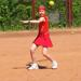 A young tennis player practicing her swing