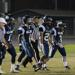 JV Football captains walking towards mid field