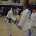 Martial arts students learning leadership qualities at a Taekwondo tournament