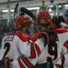 Rutgers Hockey players celebrate a goal.