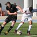 Lance Rozeboom, trying to win the battle against an FC Cincinnati player, grabbing his arm
