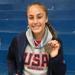 Kylee Watson flashing her gold medal