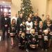 picture of the Ice Hawks and some of the firefighters taken in the lobby at the Marriott