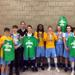 Mpls Lakers 8th Grade Boys Team poses with Championship T-Shirts after winning the Edina Cake Eater Classic Boys Basketball Tournament
