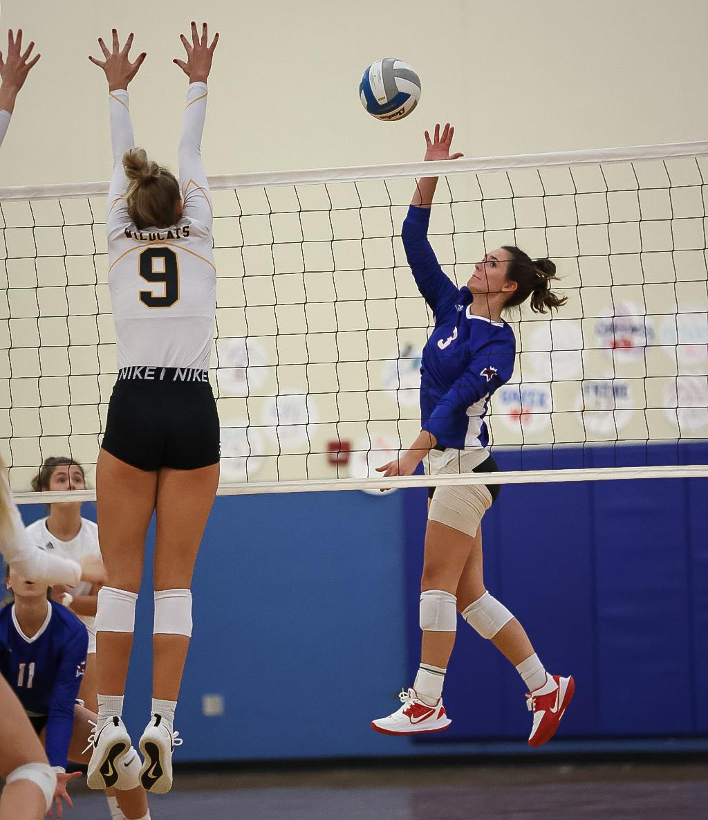 Paige Thibault (3) sends the ball past Ashlyn Olson (9) for a kill. Thibaults team-high 19 kills helped No. 4-2A Watertown-Mayer defeat No. 9-2A New London-Spicer in four sets on Thursday night. Photo by Cheryl A. Myers, SportsEngine