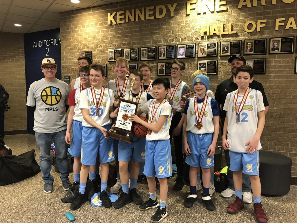 Minneapolis Lakers Boys 7th Grade Gold pose with their Medals & team trophy after taking 3rd place at the MYAS Grade State year end tournament