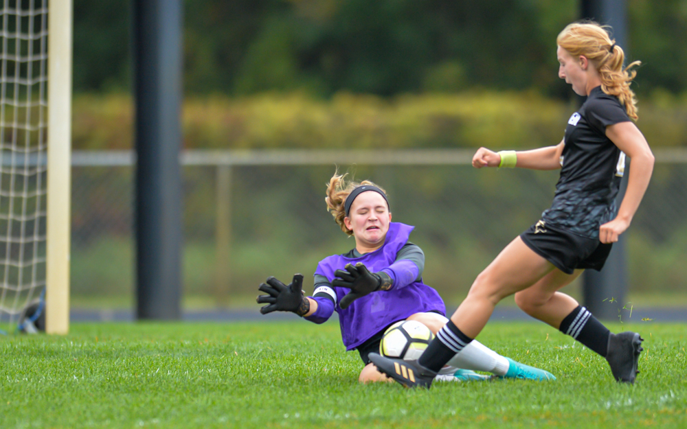 Cretin-Derham Hall goalkeeper Olivia Kalla stops Andover's Cedar Jorgenson in the first half of Saturday's game. The Raiders lost to the Huskies 4-1 in Andover. Photo by Earl J. Ebensteiner, SportsEngine