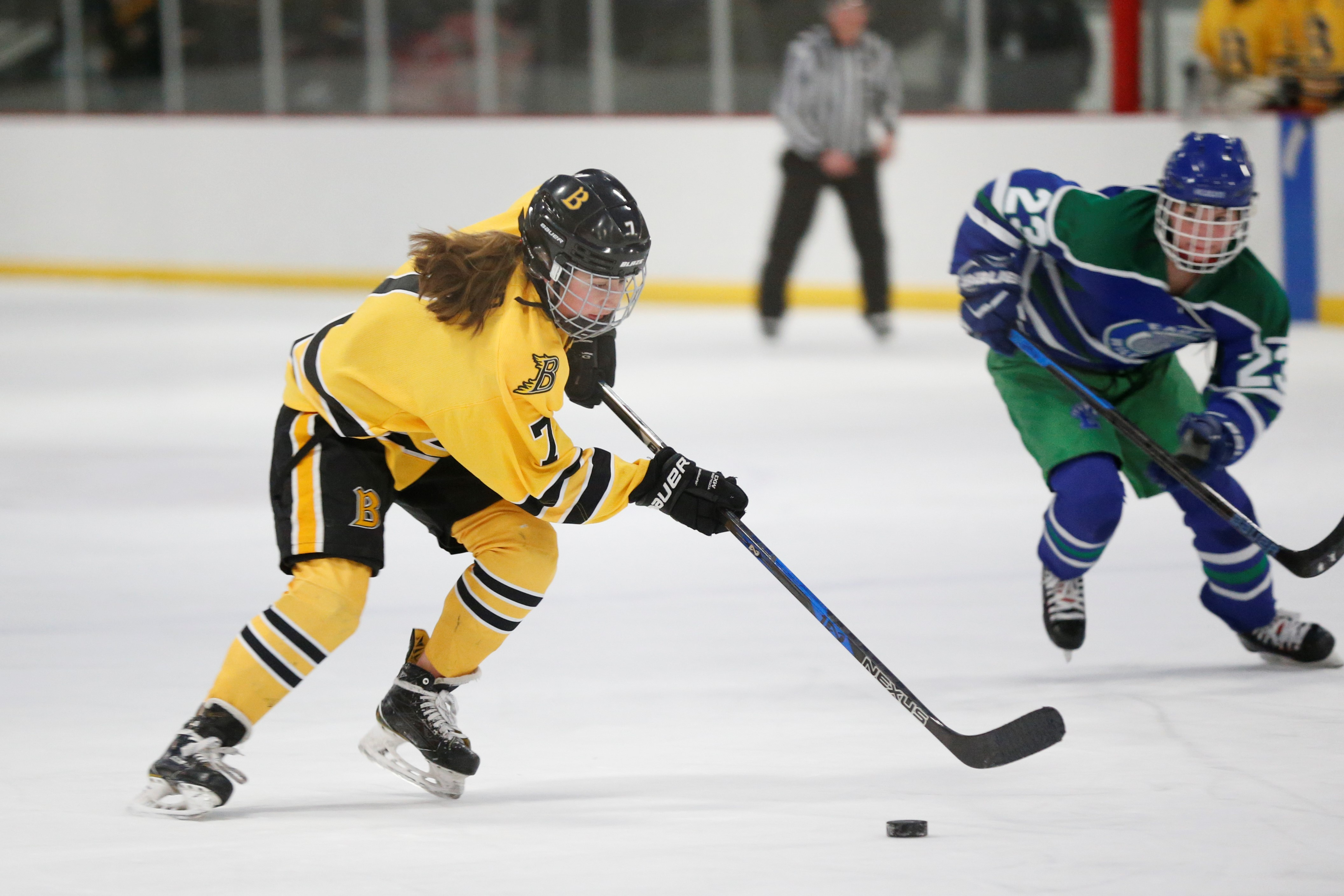 Burnsville's Allie Urlaub (7) races toward the Eagan net on a shorthanded scoring play late in the first period Wednesday night. Urlaub's goal gave the Blaze a 1-0 lead. Photo by Jeff Lawler, SportsEngine