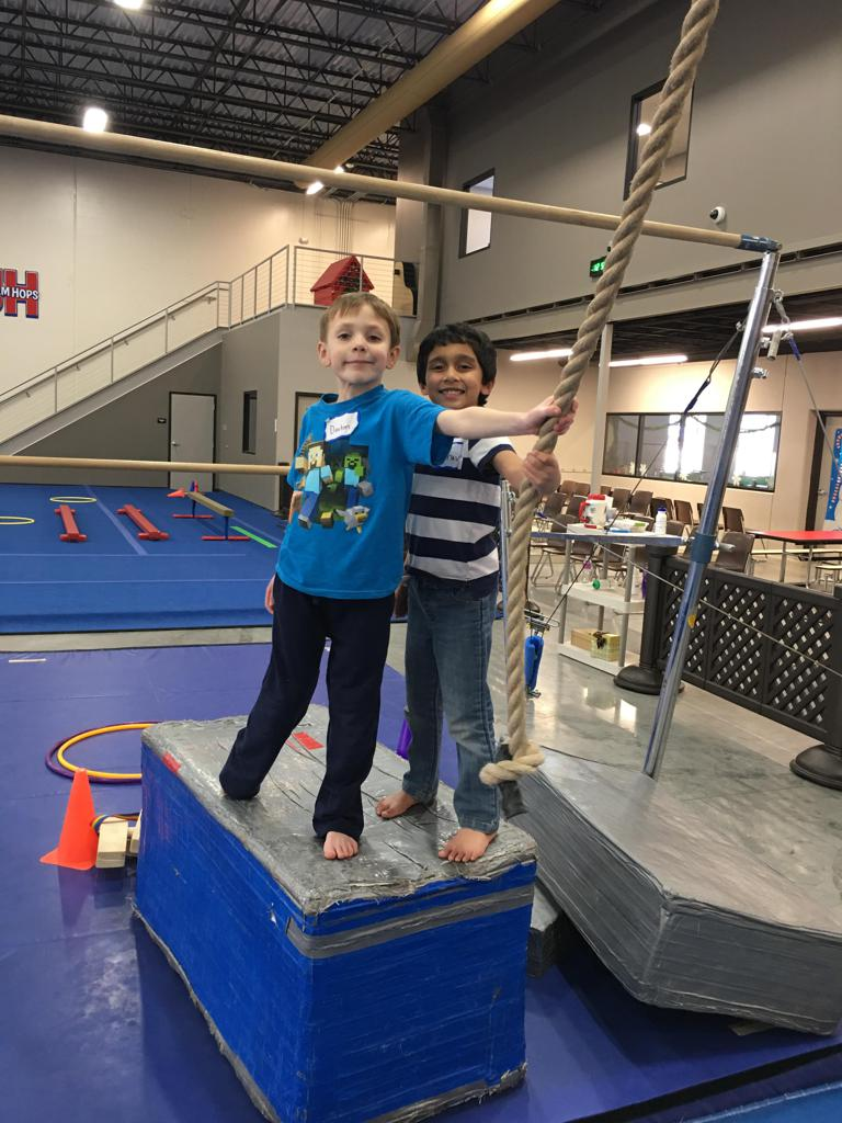 Boys climbing the rope