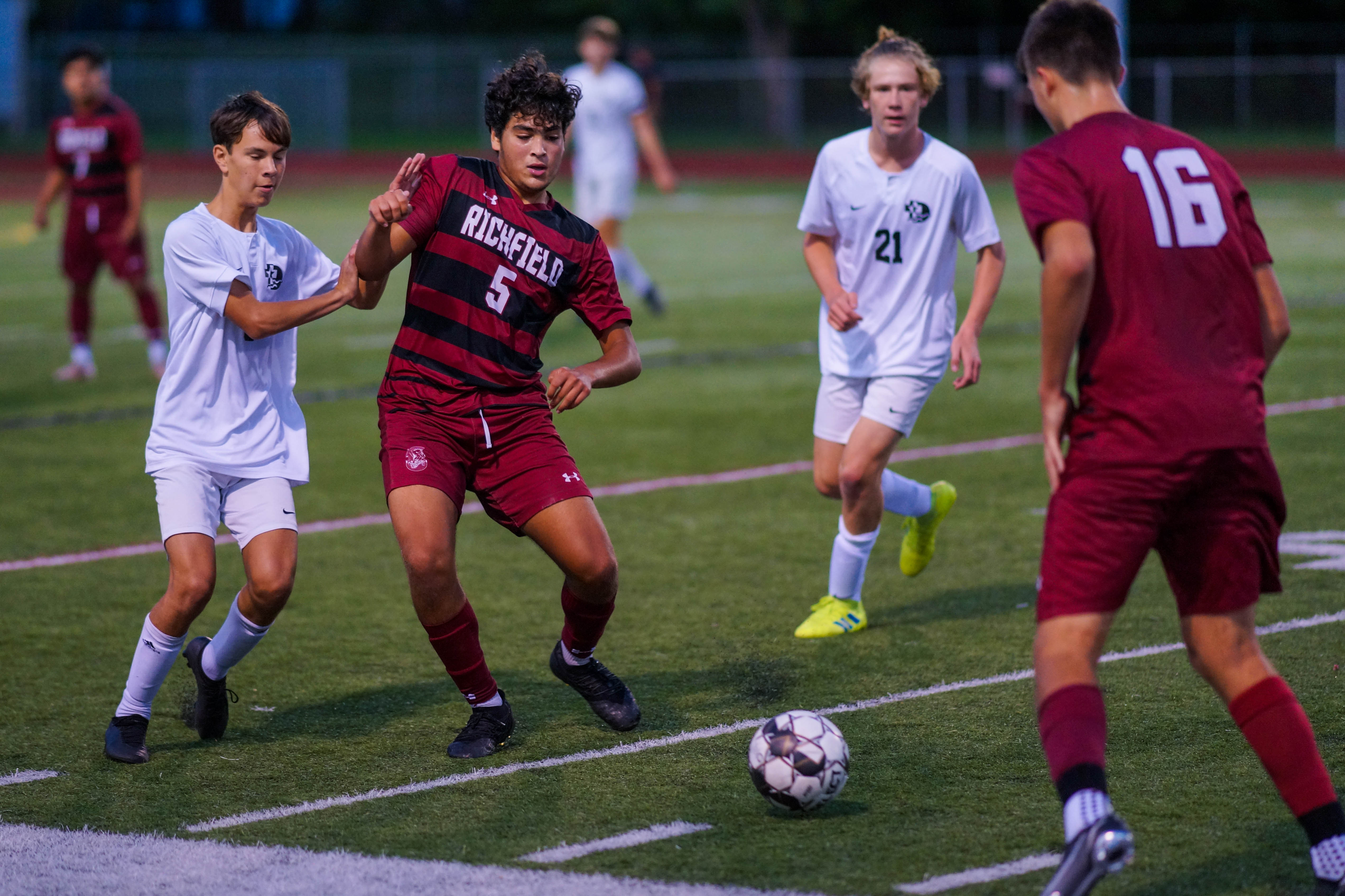 Richfield's Belal Elghorab (5) fights for position on a loose ball Thursday night against DeLaSalle. Elghorab scored the lone goal for Richfield. Photo by Korey McDermott, SportsEngine