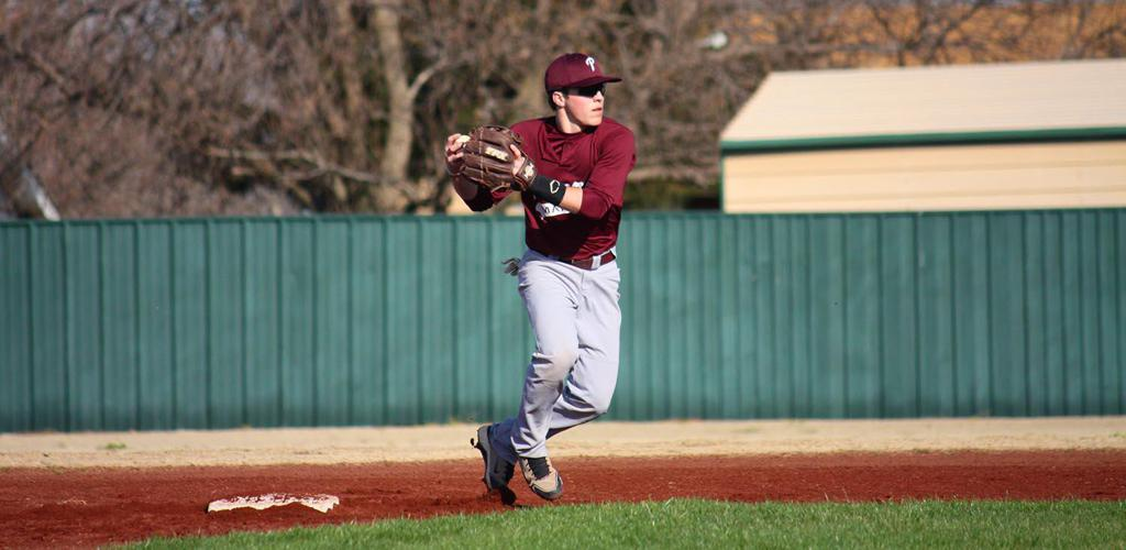 """Brendon """"BMAC"""" McLarty throwing a pitch home."""