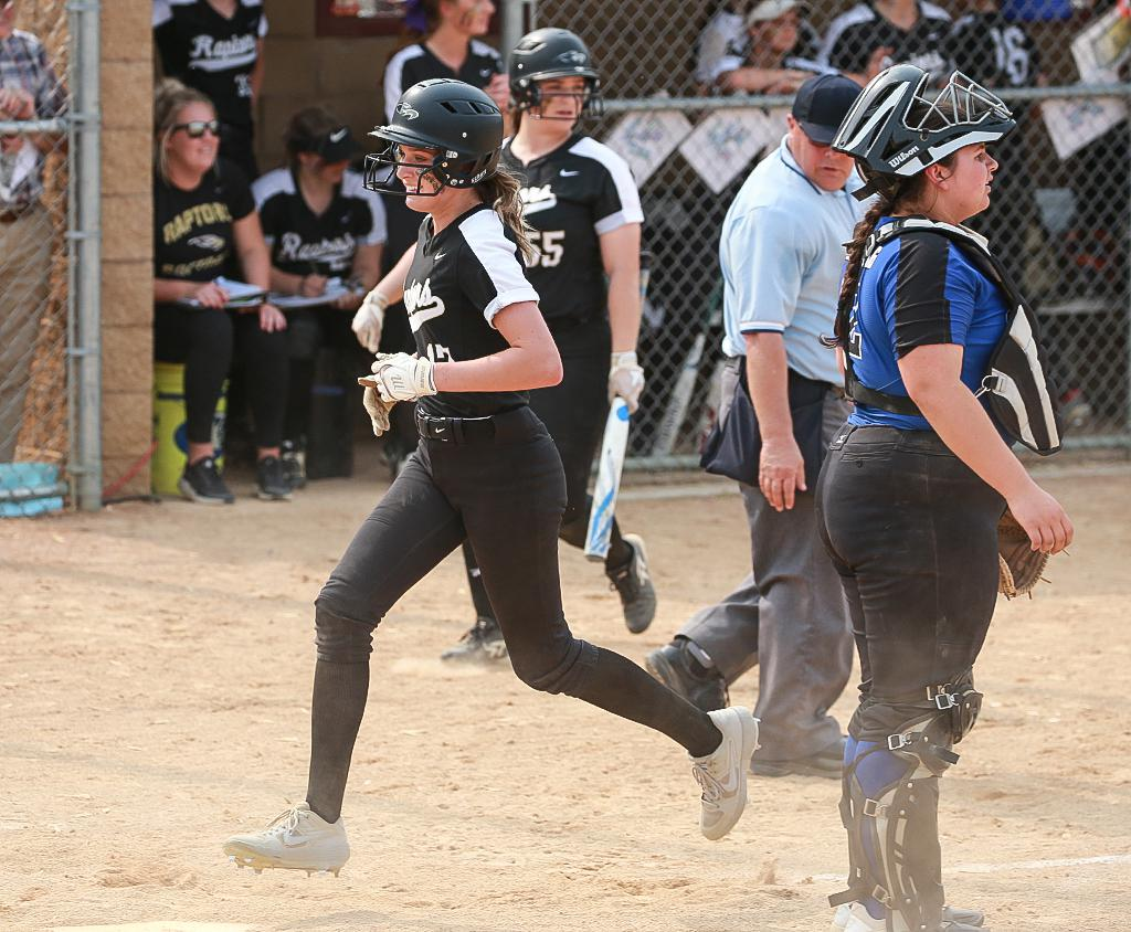 Avery Wukawitz (17) crosses home plate to score the winning run on Friday afternoon. Wukawitz led the Raptors offense with four hits in the Class 4A, Section 3 final. Photo by Cheryl Myers, SportsEngine