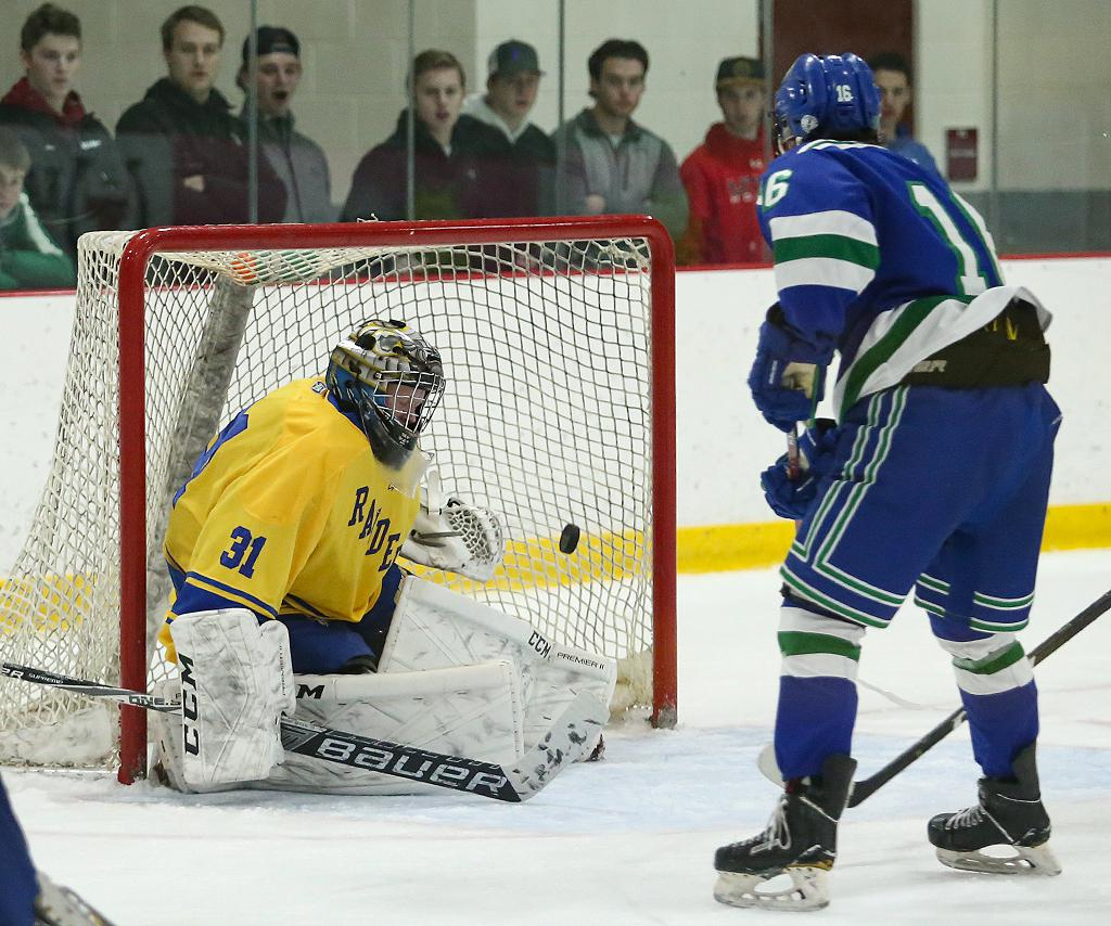 Eagan's Nick Sherek (16) finds the back of the net for a second-period short-handed goal, tying the game at two. The Wildcats threw 42 shots at the net but fell to the Raiders 4-3 in the Premier Tournament finale. Photo by Cheryl Myers, SportsEngine