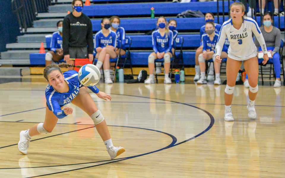 Woodbury outside hitter Kameron Monson (10) keeps the ball alive in the third set during the Royals' 3-0 loss to the unbeaten Raptors. Photo by Earl J. Ebensteiner, SportsEngine