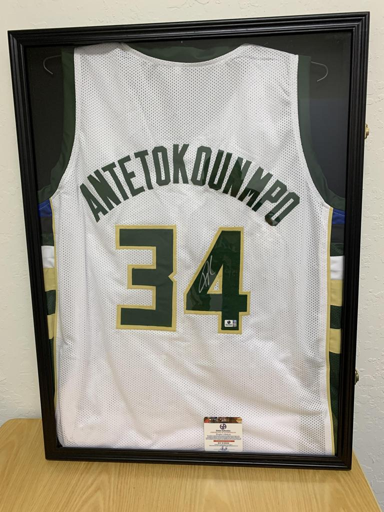 Giannis Antetokounmpo Signed Jersey.  Comes with certificate of authentication and lockable UV protected display case