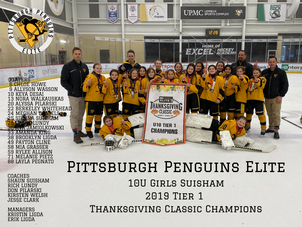 PPE10USuisham brings home the Championship Banner in the Pittsburgh Penguins Elite Thanksgiving Classic.