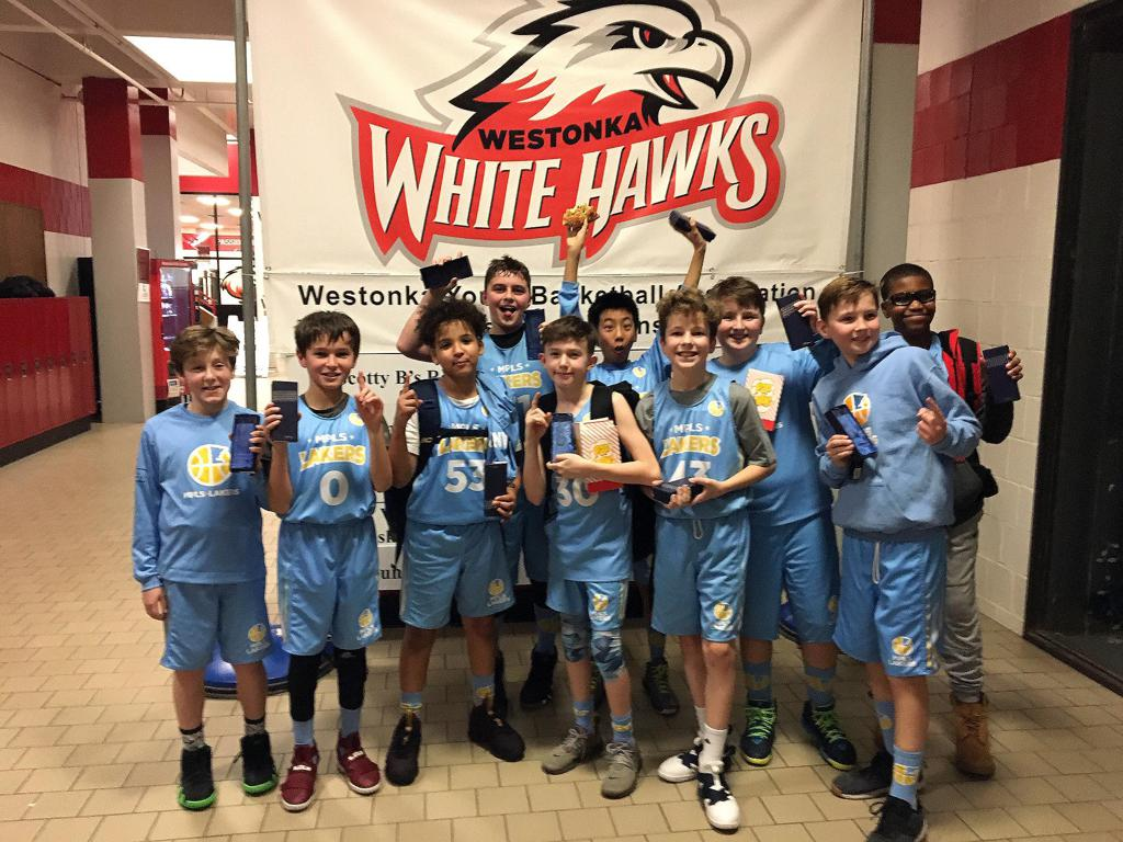 Minneapolis Lakers Boys 6th Grade Blue pose with their hardware after taking 1st at Westonka White Hawk Classic
