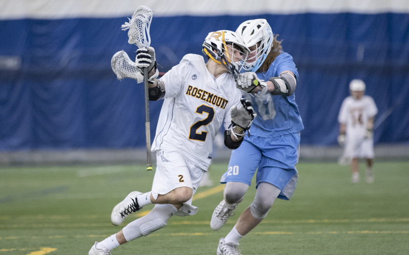 Rosemount's Evan Geiwitz tries to work around Jefferson defender Jack Vipond Thursday afternoon at the Savage Sports Center. The Irish defeated the Jaguars 9-4. Photo by Jeff Lawler, SportsEngine