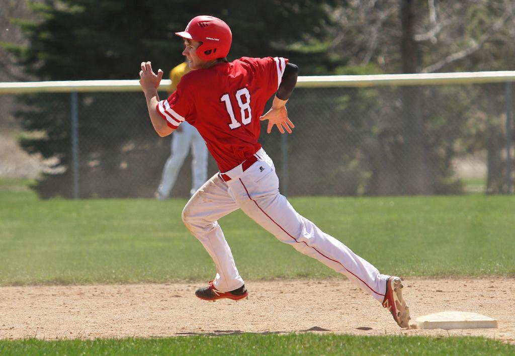 Riley Wempner rounds second base on a late game triple. Wempner broke a 1-1 tie in the top of the seventh inning with a two-run shot to center field giving Austin a 3-1 win. Photo by Cheryl Myers, SportsEngine