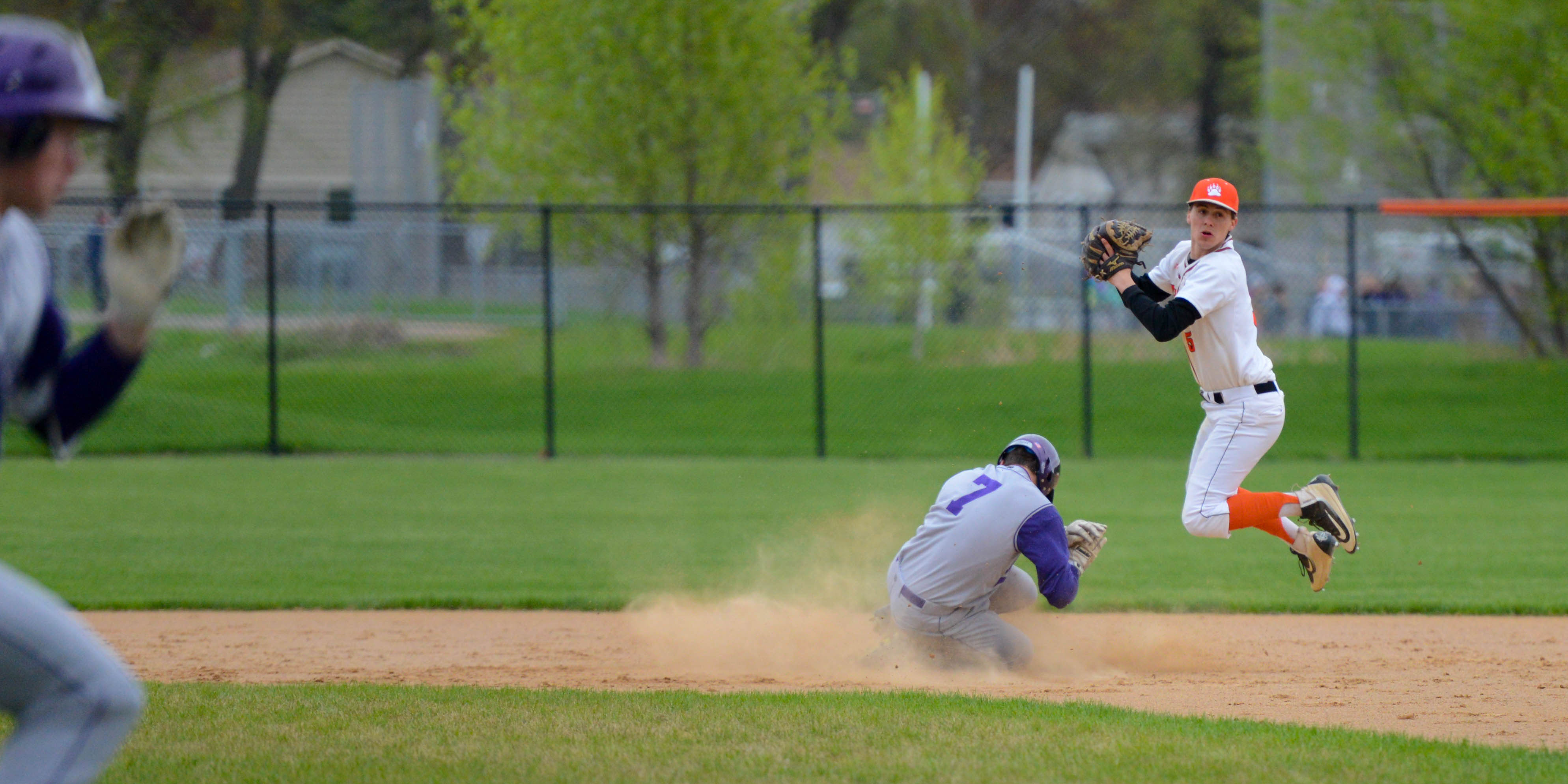 White Bear Lake second basemen Danny Lyons (5) tries to turn a double play against Cretin-Derham Hall at White Bear Lake High School's South Campus on Friday. Photo by Carter Jones, SportsEngine