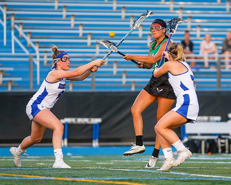 Edina's Loli Fidler shot between Minnetonka defenders Anna Brooks, left, and Kelly McCloskey to score one of her two goals. Fidler also had three assists. Photo by Mark Hvidsten, SportsEngine