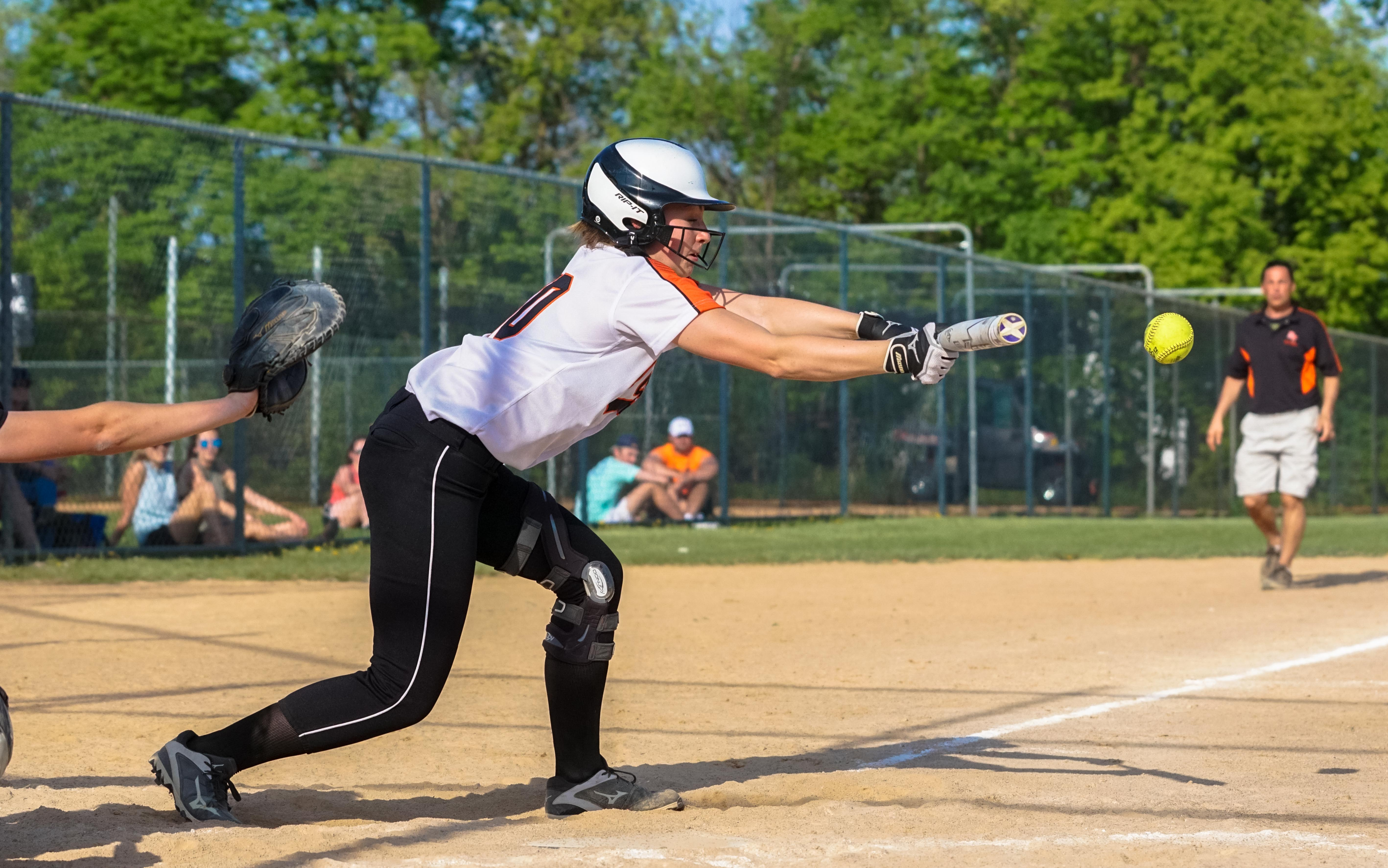 Delano's Claudia Schüler with a bases-loaded bunt Friday to score one of three runs for Delano in its victory over Waconia. Photo by Korey McDermott, SportsEngine