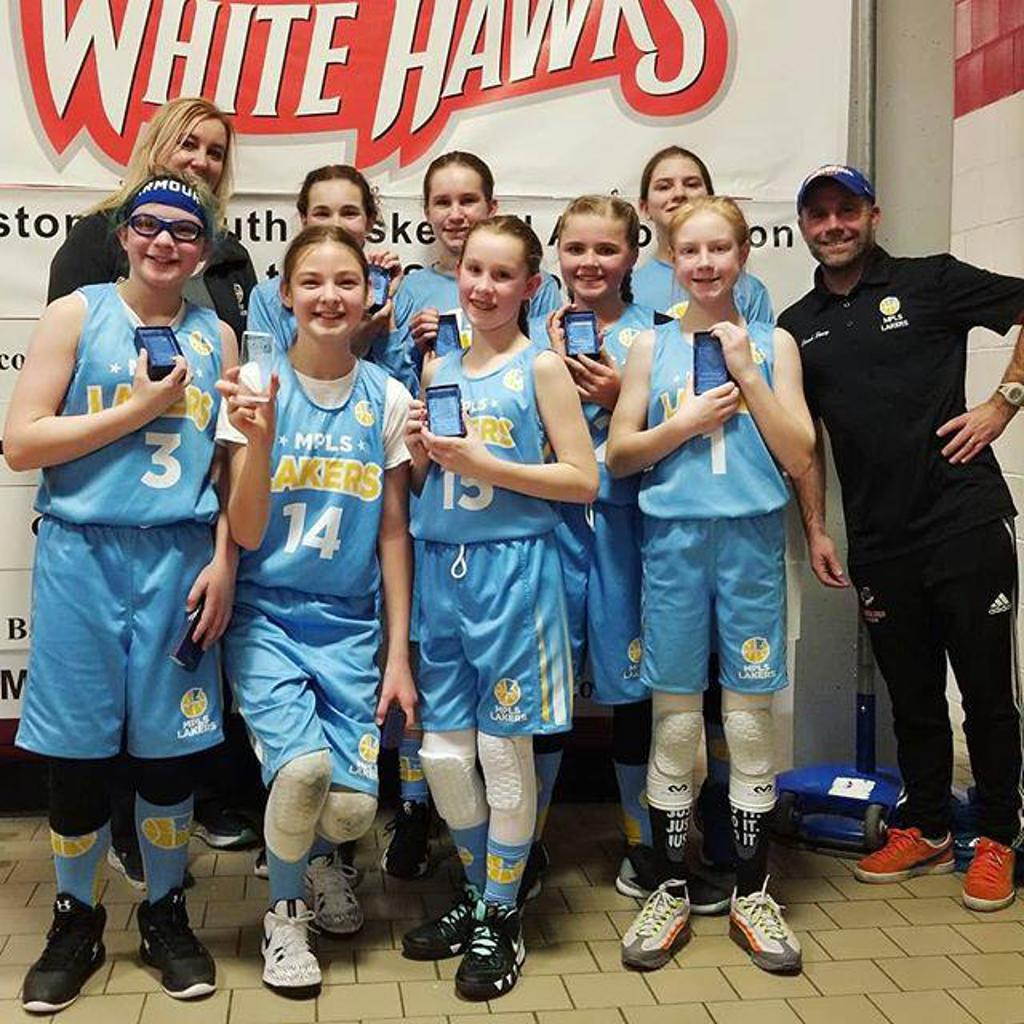 Minneapolis Lakers Girls 6th Grade Gold pose with their hardware after taking 2nd Place at Westonka White Hawk Classic