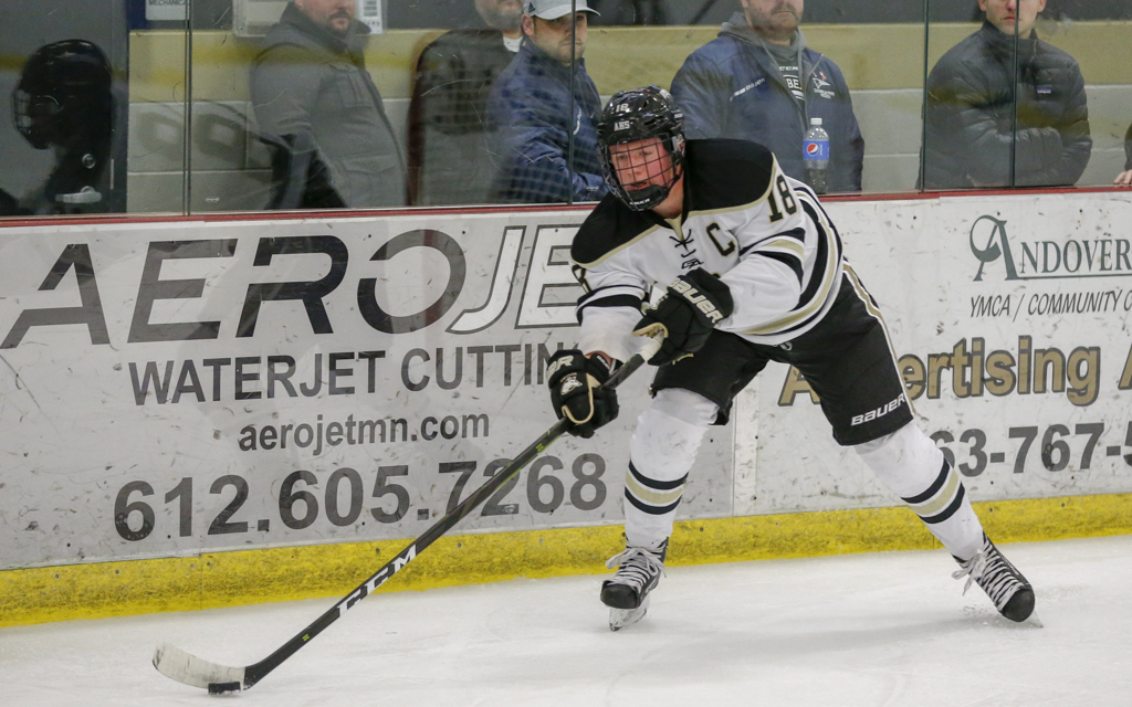 Andover defenseman Dylan Livgard moves the puck from behind his own net Saturday afternoon against Duluth East. Livgard scored the Huskies' first goal in their 2-1 overtime victory over the Greyhounds. Photo by Jeff Lawler, SportsEngine