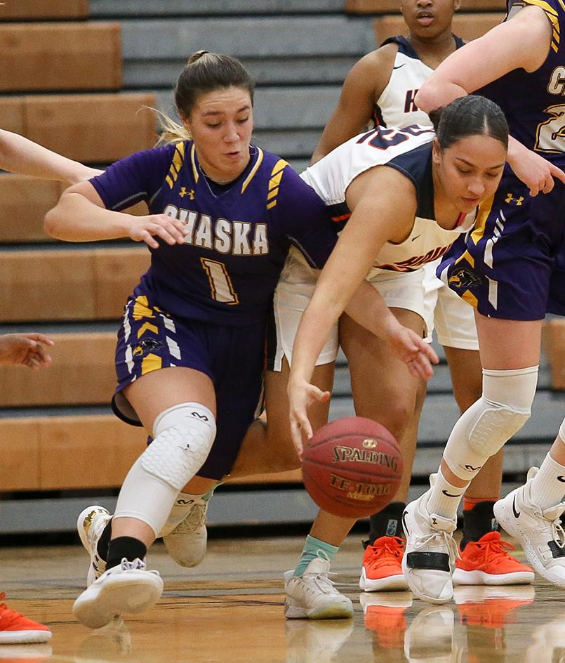 Destinee Bursch (1) dives for a loose ball late in the second half. Bursch tallied a team-high 25 points for Chaska. Photo by Cheryl Myers, SportsEngine