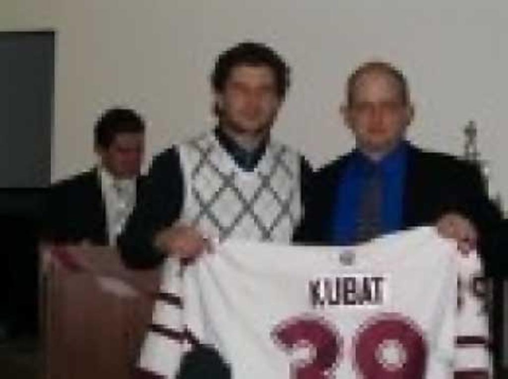 Captian Dennis Kubat recieving his jersey with trainer Jeff Woods