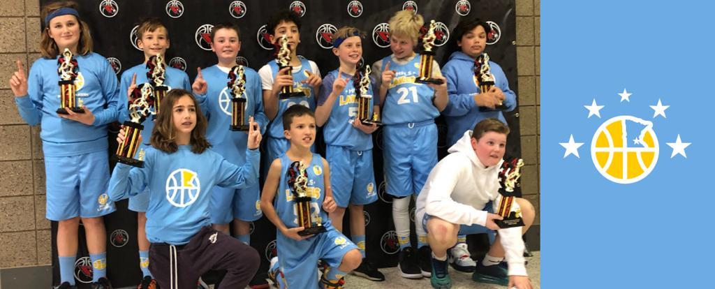 Minneapolis Lakers Boys 6th Grade White pose with their Trophies after becoming the Champions at the Coon Rapids Cardinal Classic tournament in Coon Rapids, MN