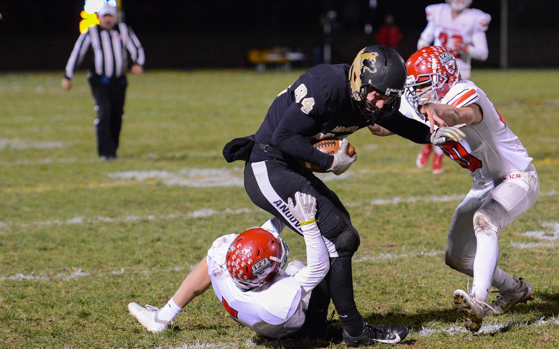 Andover wide receiver Lucas Beberg is brought down by a pair of Elk River defenders at Andover High School on Friday night. Photo by Carter Jones, SportsEngine