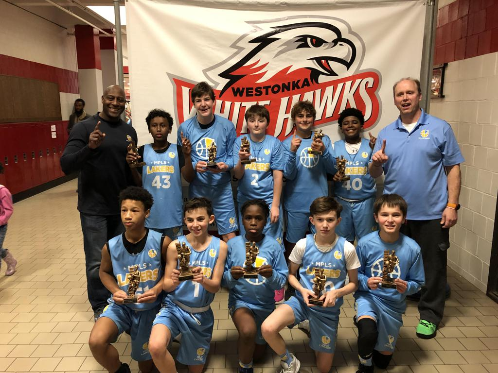 Minneapolis Lakers Youth Basketball Program Boys 7th Grade Blue pose with their Trophies after becoming the Champions at the Westonka White Hawk Classic tournament in Mound, MN