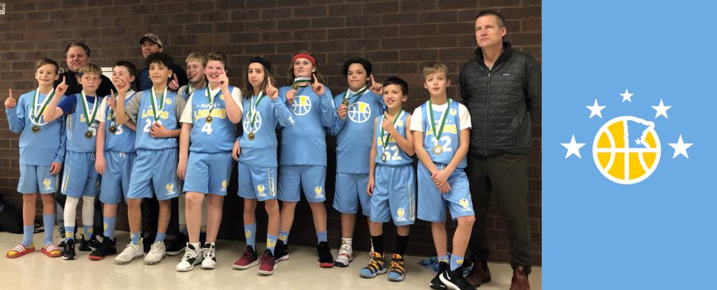 Minneapolis Lakers Boys 6th Grade White pose with their Medals after becoming the Champions at the Rockford Boys Showcase tournament in Rockford, MN