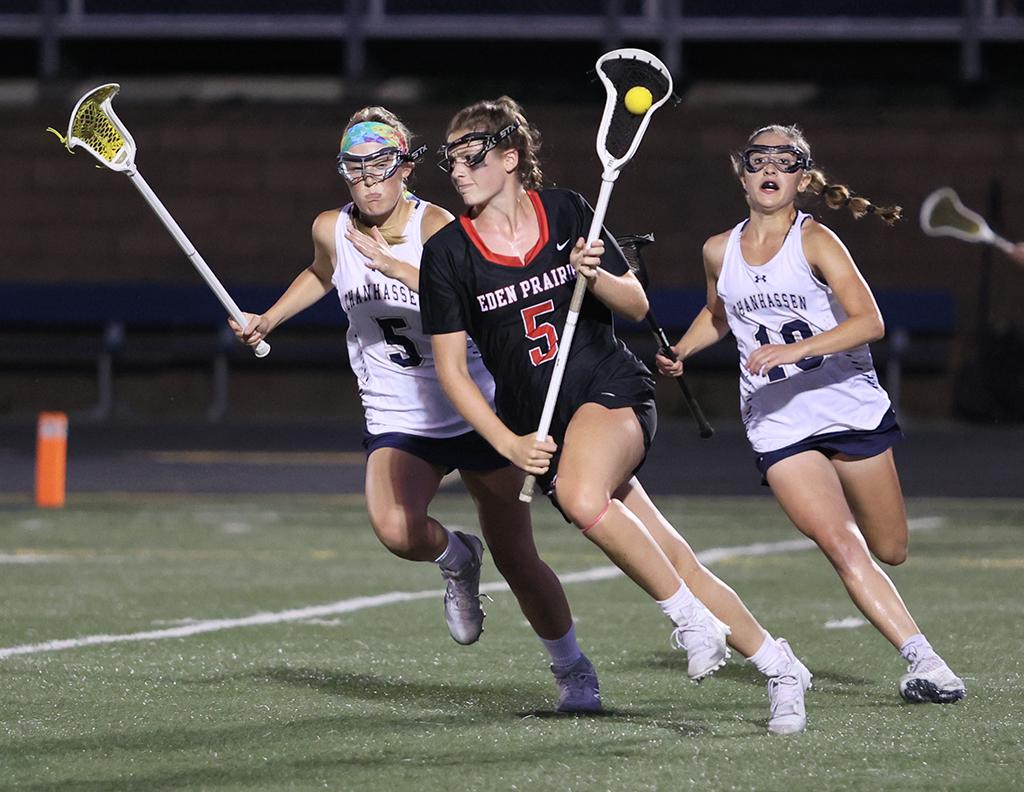 Eden Prairie's Brinley Hopper carries the ball past defender Bethany Velasco (5) in the second half. Hopper scored three goals, including tying and go-ahead goals late in the game. Photo by Cheryl A. Myers, SportsEngine