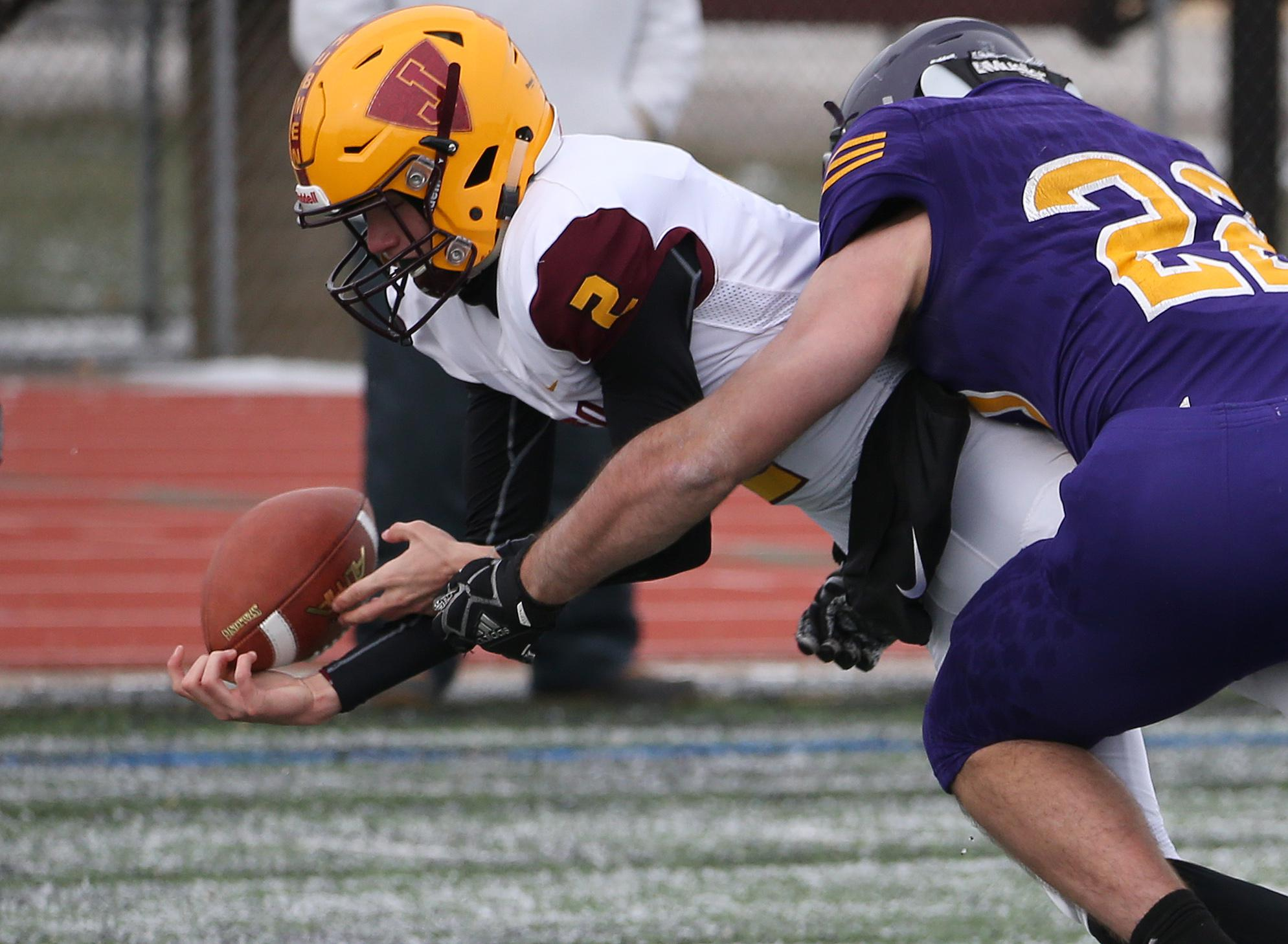 Bryce Sievers (2) is brought down by Jake Groteboer (22) forcing a turnover on the opening drive of the game. Jordan fell to Rochester Lourdes 24-0 after suffering four turnovers in the first half. Photo by Cheryl Myers, SportsEngine