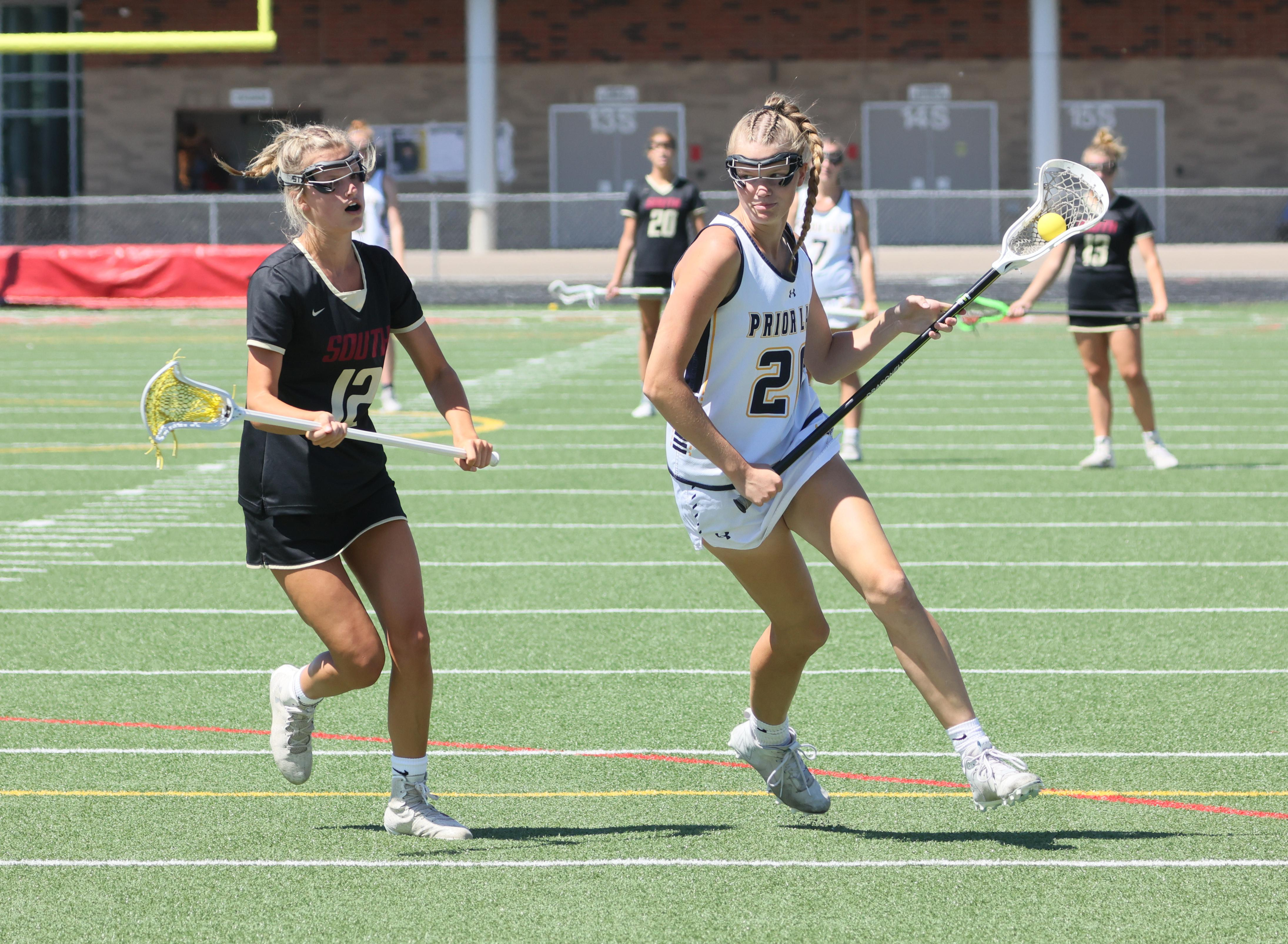 Payton Bloedow moves upfield in the state championship game against Lakeville South June 18. Bloedow was named 2021 Ms. Lacrosse. Photo by Cheryl A. Myers, SportsEngine