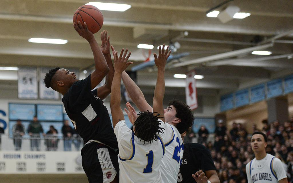 Richfield junior Lamar Grayson (left) leaps to take a shot against Holy Angels in the Class 3A, Section 3 championship at Bloomington Jefferson High School on Thursday night. Grayson had a game-high 26 points in the 67-53 win. Photo by Carter Jones, Sport