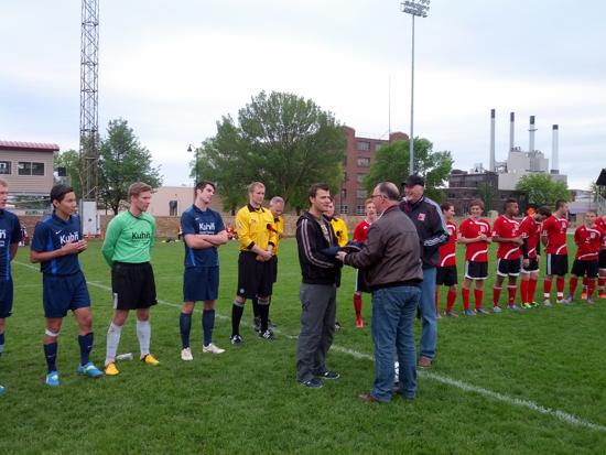 Madison 56ers NPSL general manager Cristian Brei and club president Tom Mooney, right, exchange gifts with SV Blau-Weiss Wiehre Freiburg club president Bernhard Bucher before Saturday's friendly.