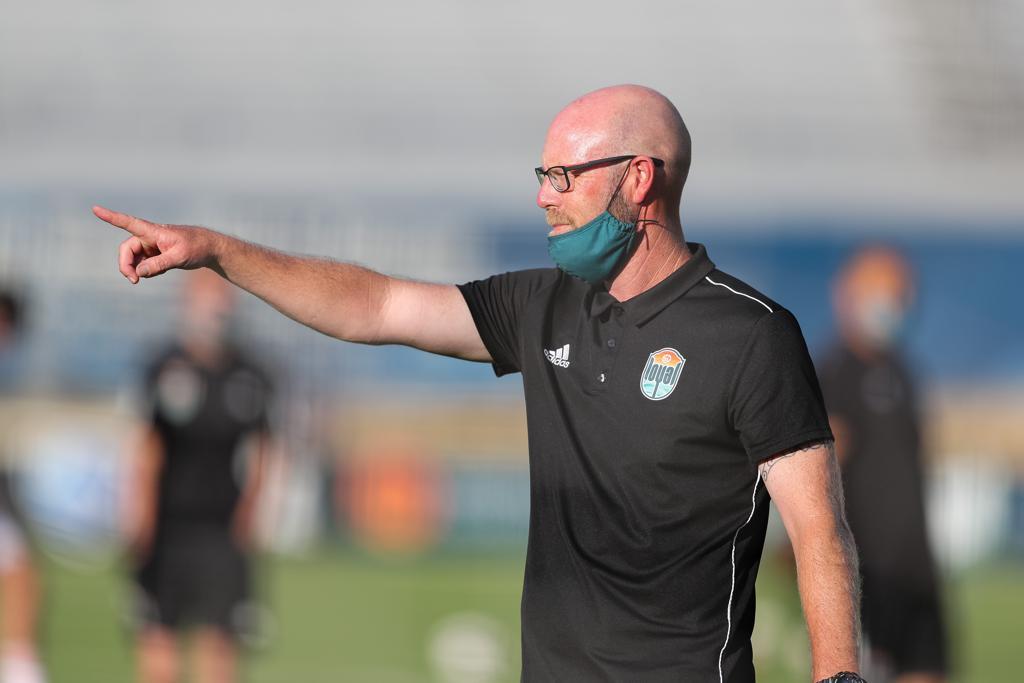 Head Coach Matt Hall coaching the team.