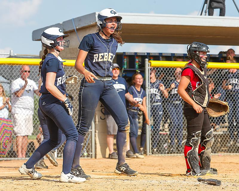 Holly Blaska, middle, celebrated a sixth-inning run. She doubled after being walked seven consecutive times during the two games and scored on another double by Abby Gilk. Photo by Mark Hvidsten, SportsEngine
