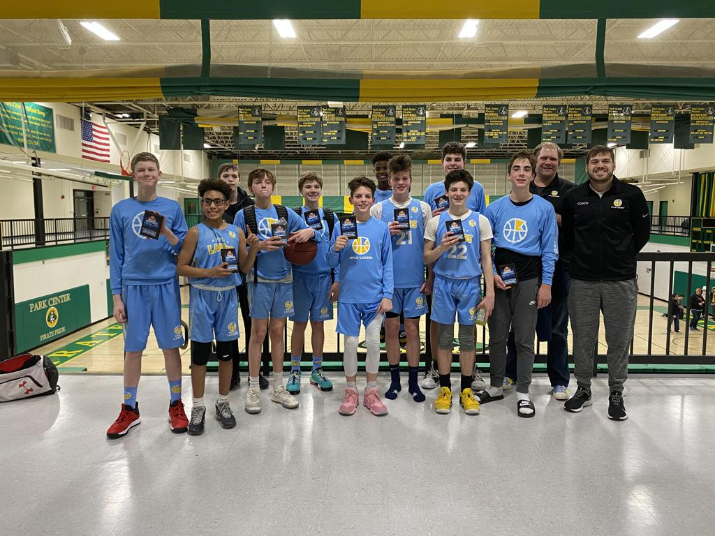 Mpls Lakers Youth Traveling Basketball Program Inc Boys 8th Grade Gold pose with their Trophies after becoming the Champions at the Park Center Winter Shootout tournament in Brooklyn Park, MN